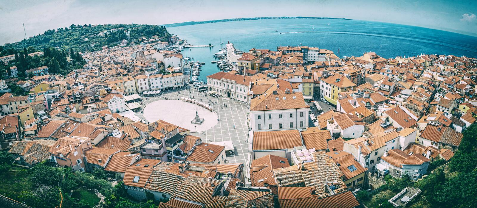 Piran town from St. George`s Parish church, analog filter. Piran town from St. George`s Parish church, Slovenia. Tartini square. Panoramic photo. Travel royalty free stock photo
