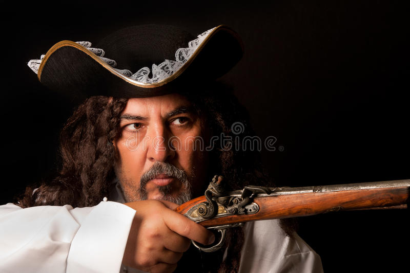 Pirata con la pistola fotos de archivo