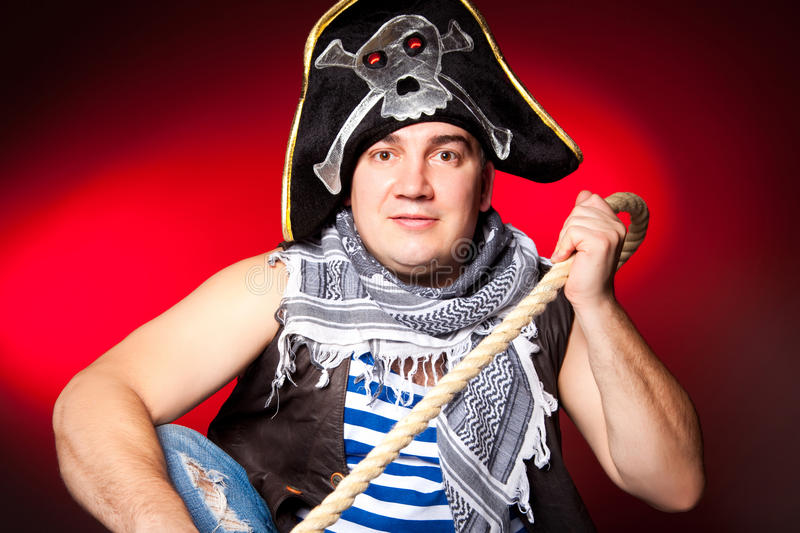 Pirate with a cocked hat and a rope stock photography