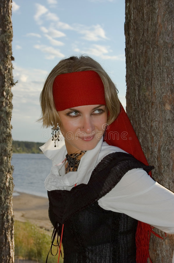 Pirate girl. Pirate hiding in a forest stock images