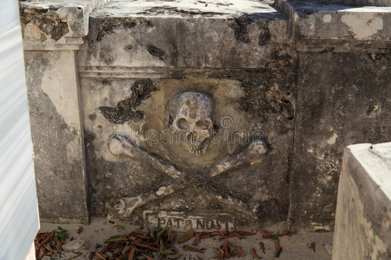 Pirate Gravestone. Scull and crossbones mark the gravestone of an very old pirate of the Caribbean named Fermin Antonio Mundaca on Isla Mujeres, Mexico royalty free stock photo