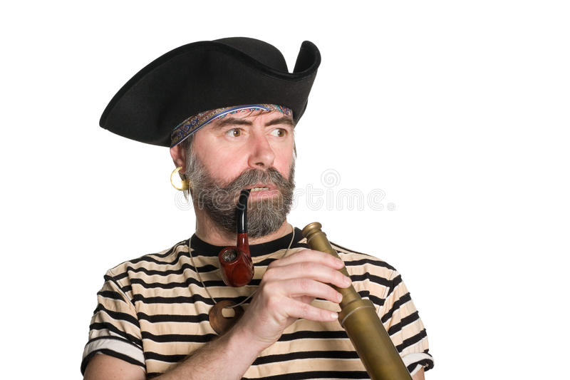 Pirate keeps a telescope. Pirate keeps his telescope and looks anxiously to the side royalty free stock photo