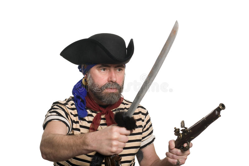 Pirate with a musket and sword. Terrible pirate tricorn hat with a musket and sword stock photos