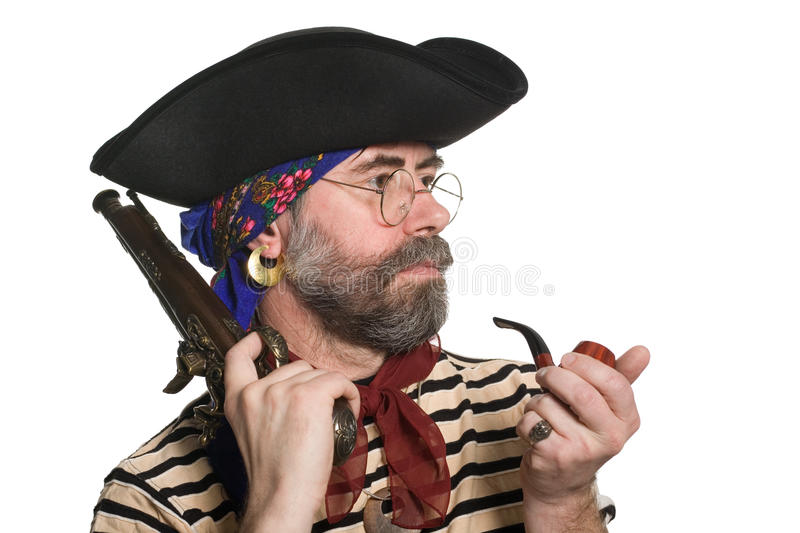 Pirate with a pipe and a musket. Isolated on white royalty free stock photos
