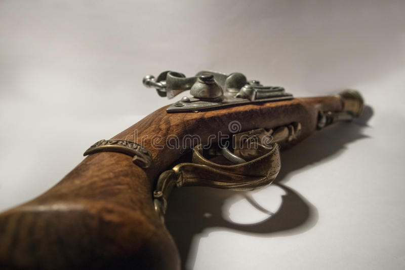 Pirate pistol. Isolated on white background royalty free stock photography