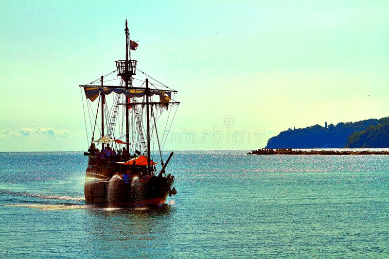 Pirate ship at the open sea royalty free stock photo