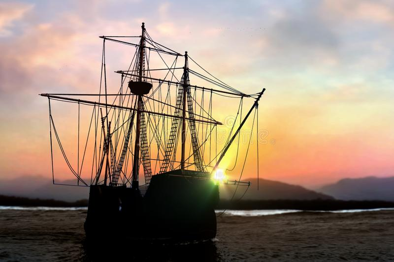 Pirate ship at the open sea during  sunset royalty free stock photography