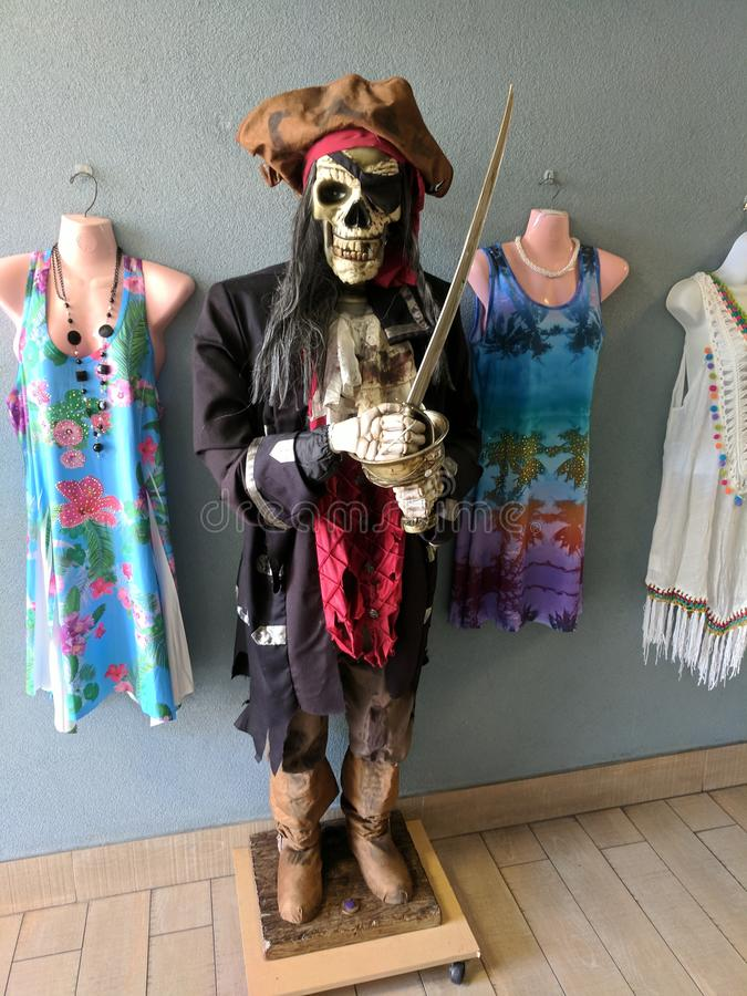 Pirate skeleton statue outside clothing shop royalty free stock photography