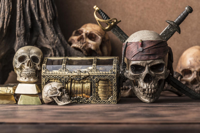 Pirate skull concept still life style. Pirate skull and human skeleton with gold and treasure coffer halloween concept still life style stock images