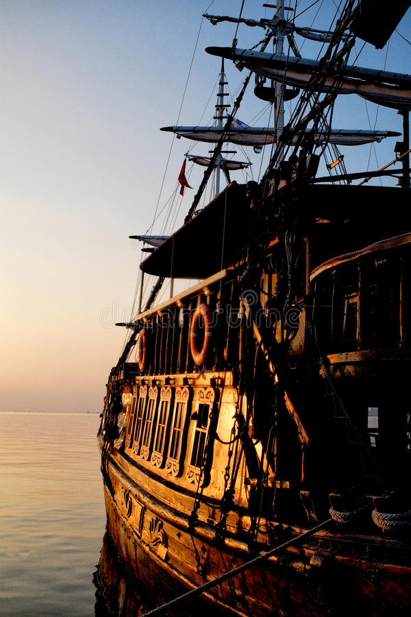 Pirates of Aegean sea. An old pirates ship in sunset royalty free stock photography
