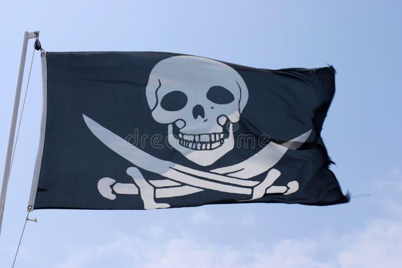 Pirates flag. Over blue sky stock image