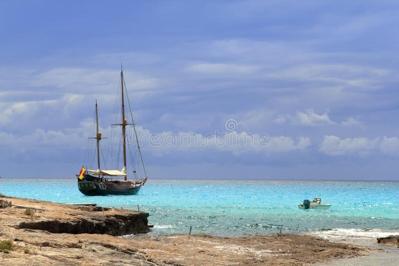Download Pirates Inspired Wood Sailboat Anchored Turquoise Stock Photo - Image: 15433866