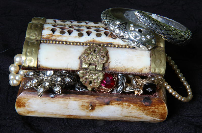 Piratical chest. With riches inside royalty free stock image