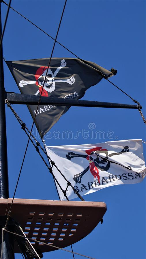 Piratkopiera flaggor arkivfoto