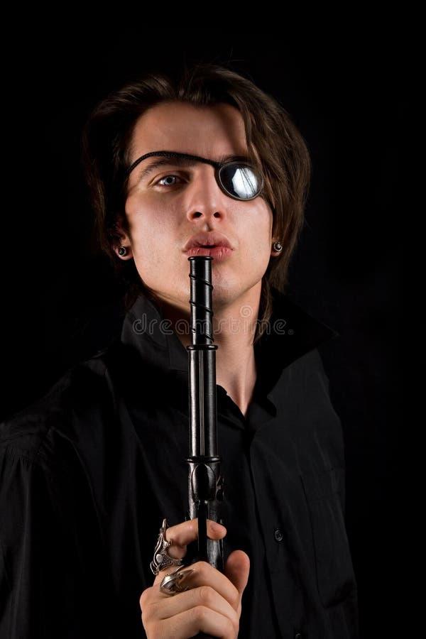 piratkopierar den stiliga lappen för ögontrycksprutan skytte fotografering för bildbyråer