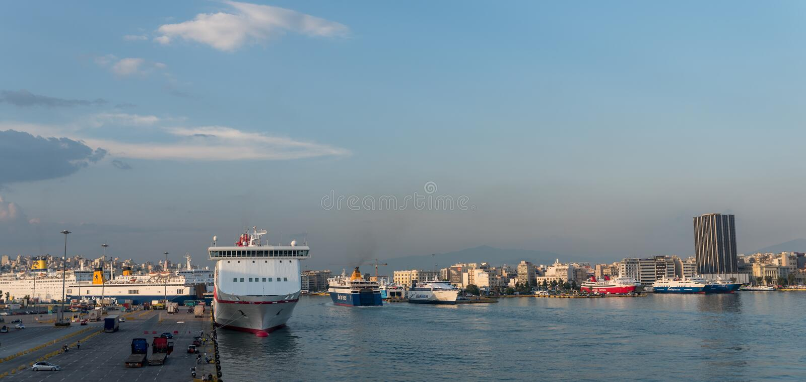 Pireaus Greece/ June 18, 2018: Panaroma of Pireaus Harbor in Greece. Pireaus Greece/ June 18, 2018: Ferries in Pireaus Harbor Greece lined up and ready to depart royalty free stock image