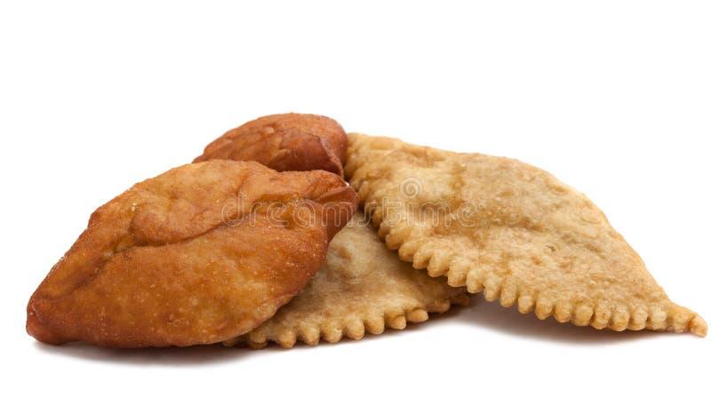 Piroger och pies. Isolerat på vit royaltyfri fotografi
