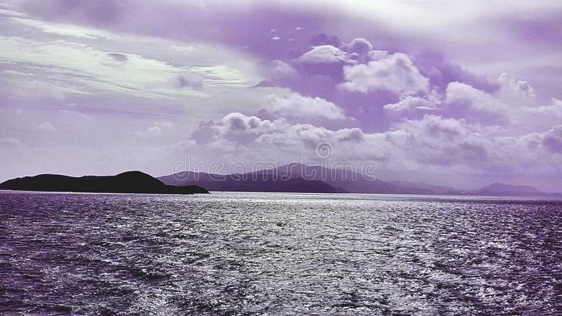 Purple Skies. Beauiful purple sky above a cluster of the virgin islands stock image