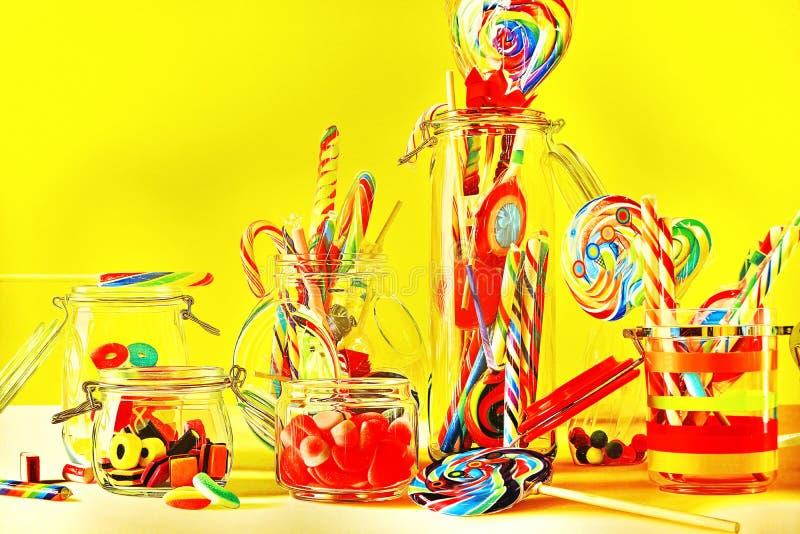 Piruletas y candys dulces coloreados fotos de archivo