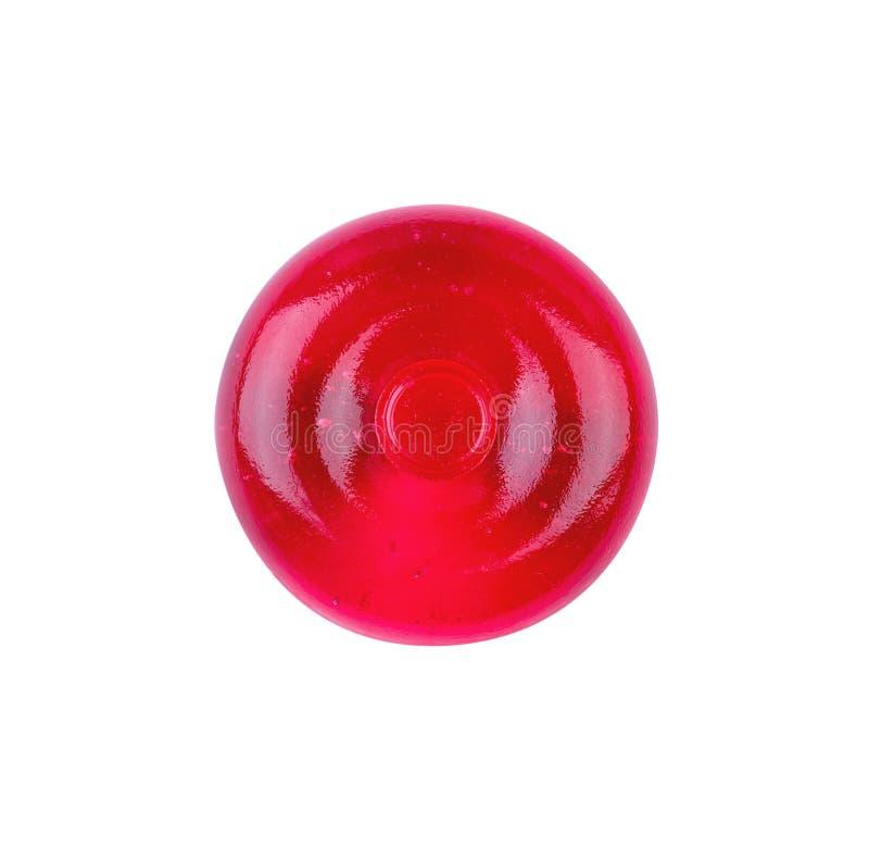Pirulito redondo vermelho isolado no fundo branco imagem de stock royalty free