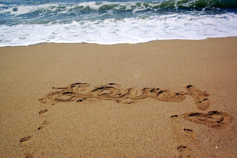 pisać miłość piasek obraz stock