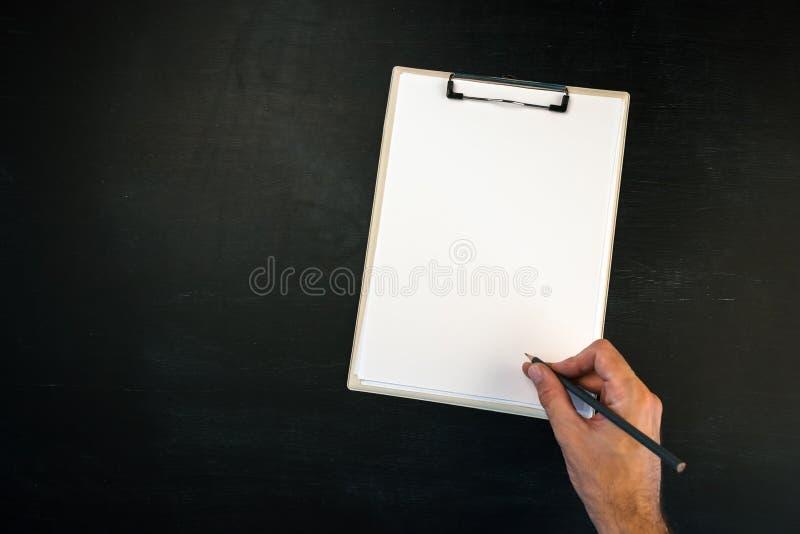 Pisać na schowku jako kopii przestrzeń, pusta strona zdjęcia royalty free