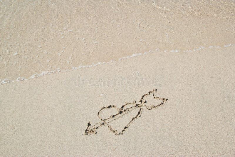 Pisać w piasku na plaży obraz royalty free