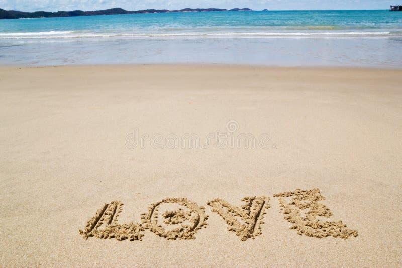 Pisać w piasku na plaży zdjęcie royalty free