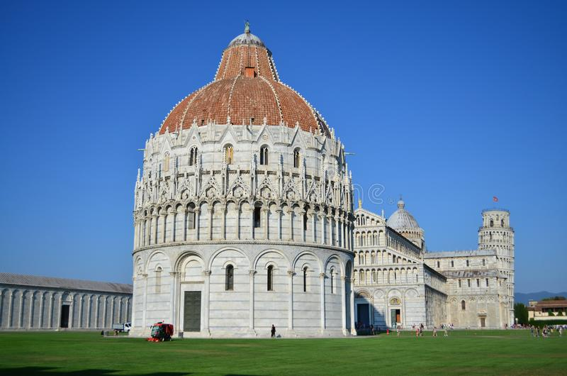 Pisa baptistery cathedral and famous Leaning Tower. Romanesque and gothic architecture. Pisa. Tuscany. Italy. stock photo