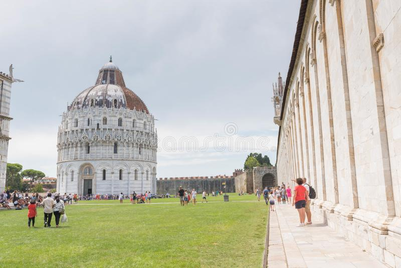 Pisa Baptistery, Italy. The Pisa Baptistery of St. John  is a Roman Catholic ecclesiastical building in Pisa, Italy. Construction started in 1152 to replace an stock photography