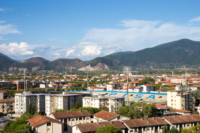 Pisa Cityscape with Arena Garibaldi Stadium in Tuscany, Italy. PISA, ITALY - August 2, 2015: Village of Pisa in Tuscany, Italy showing rooftops, Garibaldi stock images