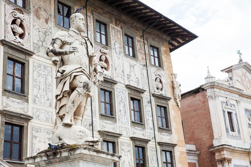 Statue of Cosimo I de Medici in front of Palazzo della Carovana built in 1564 located at the palace. The statue of Cosimo I de Medici in front of Palazzo della royalty free stock images