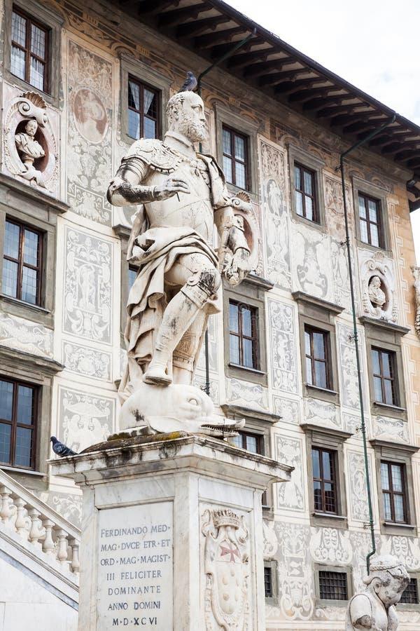 Statue of Cosimo I de Medici in front of Palazzo della Carovana built in 1564 located at the palace. The statue of Cosimo I de Medici in front of Palazzo della royalty free stock photography