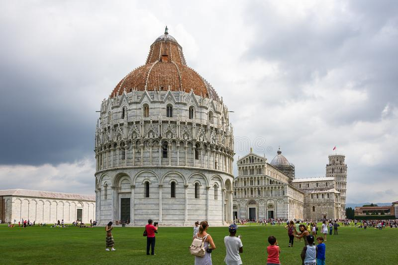 Panoramic view of Piazza dei Miracoli also called Piazza del Duomo of Pisa, in the foreground the Baptistery immediately after royalty free stock images
