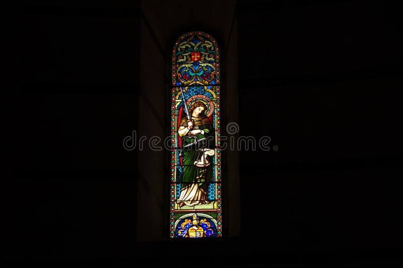 Pisa, Italy - May 24, 2018: colorful stained glass window inside Pisa Baptistery of St. John Battistero di San Giovanni at. Colorful stained glass window inside royalty free stock images