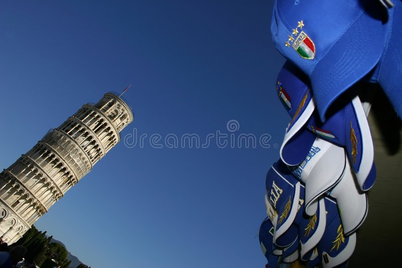 Pisa, the leaning tower and Italy caps stock image