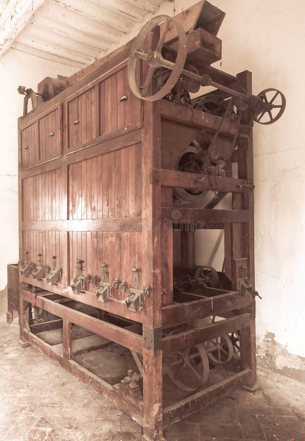 Pisa - May 25, 2019 - Old raking machine inside a Tuscan villa stock images