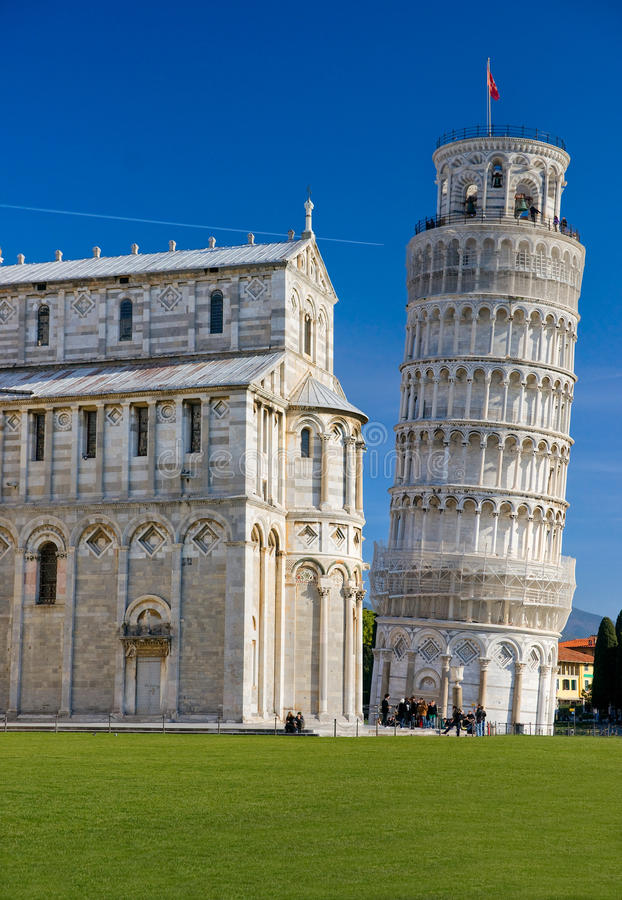 Pisa, Piazza dei miracoli. Pisa, Piazza dei miracoli, with the Basilica and the leaning tower. Shot with polarizer filter royalty free stock photos