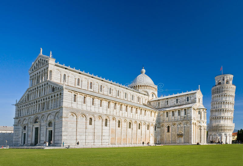 Pisa, Piazza dei miracoli. Pisa, Piazza dei miracoli, with the Basilica and the leaning tower. Shot with polarizer filter royalty free stock photography