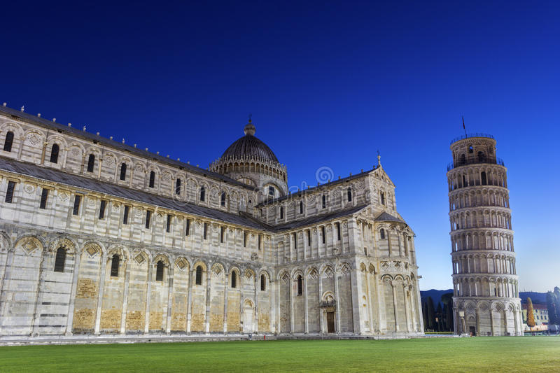 Pisa's Cathedral Square with the Tower of Pisa and the Cathedral. In Italy stock photo
