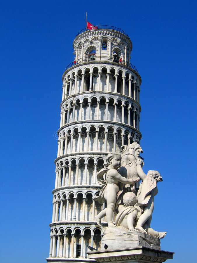 Pisa tower and statue royalty free stock photography