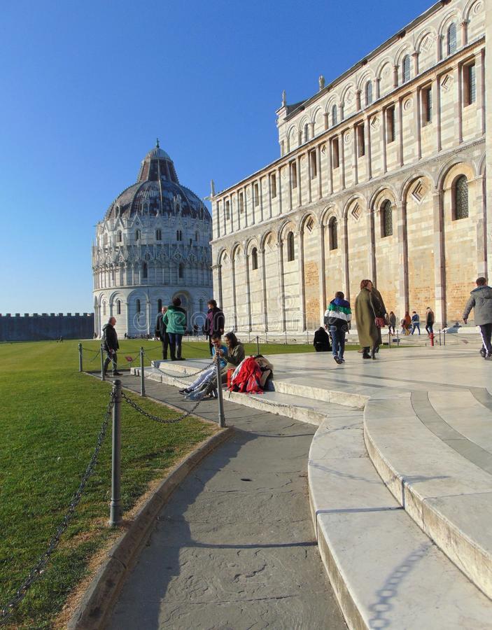 Pisa Tuscany Italy. Square of Miracles, Piazza dei Miracoli with tourists. royalty free stock photo