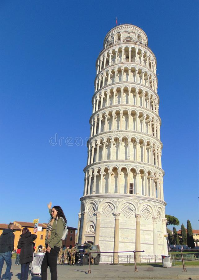 Pisa Tuscany Italy. Leaning tower of Pisa with tourists. royalty free stock photo