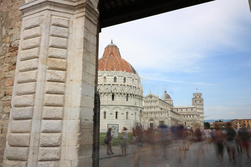Piazza dei Miracoli of Pisa seen from a door of the city walls. Pisa, Tuscany, Italy. 06/21/2019. Piazza dei Miracoli of Pisa seen from a door of the city walls royalty free stock image