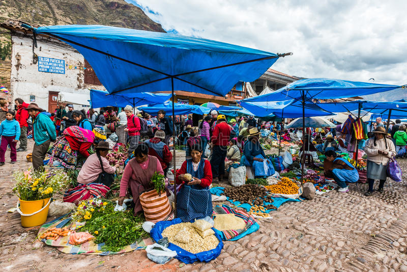 Pisac Market peruvian Andes Peru. Pisac, Peru - July 14, 2013: people in the Pisac Market in the peruvian Andes at Pisac Peru on july 14th, 2013 stock image