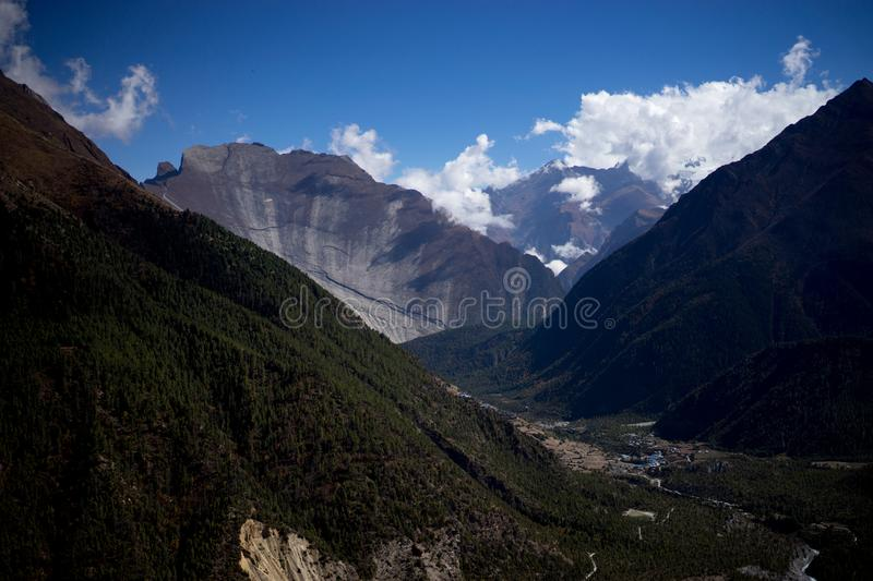 Peak and Forest in the Himalaya mountains, Annapurna region, Nepal stock photography