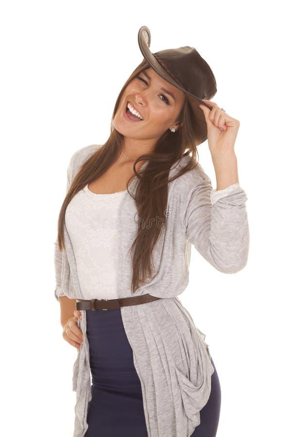 Piscadela ocidental cinzenta e azul da mulher do chapéu foto de stock royalty free