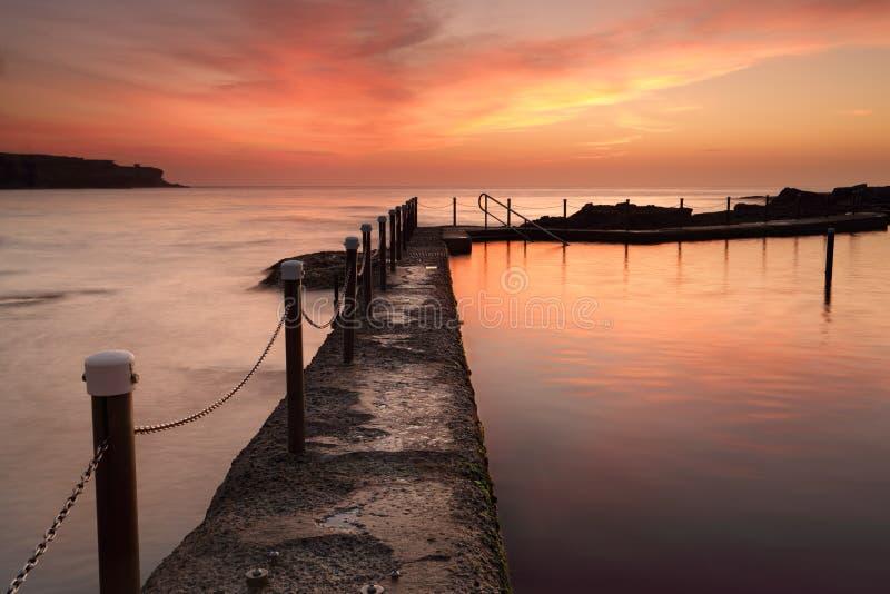 Piscine d'océan de Malabar à l'Australie de lever de soleil d'aube photographie stock