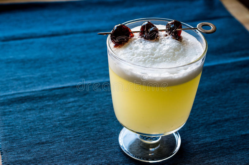 Pisco Sour Cocktail with cherry natural light royalty free stock image