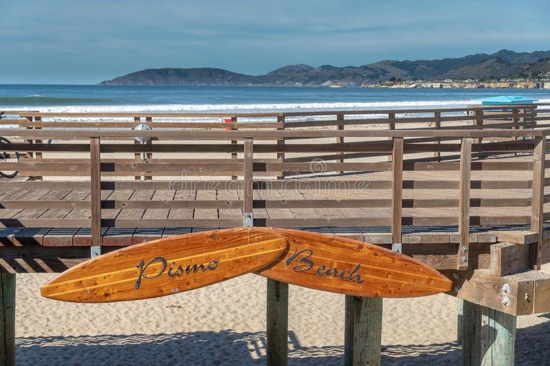 Pismo Beach Boardwalk. With beach in background, landscape, sunset, blue, california, central, coast, footprints, light, long, ocean, pacific, people, pier royalty free stock photo